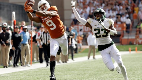 <p>               Texas wide receiver Collin Johnson (9) makes a catch in front of Baylor cornerback Derrek Thomas (23) for 44-yard touchdown reception during the first half on an NCAA college football game, Saturday, Oct. 13, 2018, in Austin, Texas. (AP Photo/Eric Gay)             </p>