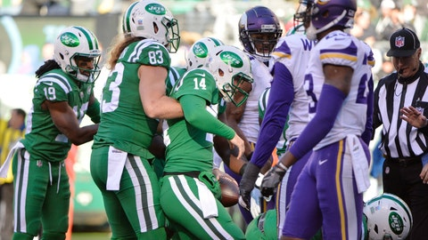 <p>               New York Jets quarterback Sam Darnold (14) is helped up by teammate Eric Tomlinson (83) after rushing for a touchdown during the second half of an NFL football game Sunday, Oct. 21, 2018, in East Rutherford, N.J. (AP Photo/Howard Simmons)             </p>