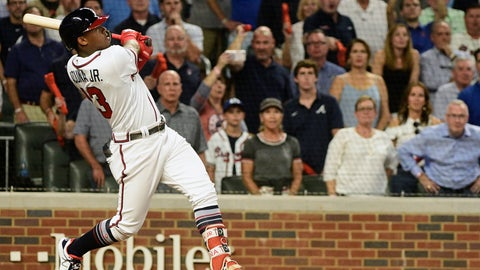 <p>               Atlanta Braves left fielder Ronald Acuna Jr. (13) hits a grand-slam homer against Los Angeles Dodgers starting pitcher Walker Buehler during the second inning in Game 3 of MLB baseball's National League Division Series, Sunday, Oct. 7, 2018, in Atlanta. (AP Photo/John Amis)             </p>