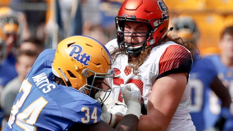 "<p>               FILE--In this Oct. 6, 2018, file photo, Syracuse offensive lineman Koda Martin, right, blocks Pittsburgh defensive lineman Amir Watts (34) during an NCAA football game in Pittsburgh. Martin and  Pittsburgh safety Dennis Briggs didn't want to wait until after college to get married. So they didn't. One of the factors that helped them take the plunge: the financial buffer provided by the NCAA's ""cost of attendance"" provision. (AP Photo/Keith Srakocic, File)             </p>"