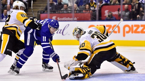 <p>               Toronto Maple Leafs centre Zach Hyman (11) is stopped by Pittsburgh Penguins goaltender Matt Murray (30) as Pittsburgh Penguins left wing Carl Hagelin (62) defends during second period NHL hockey action in Thursday, Oct. 18, 2018. (Frank Gunn/The Canadian Press via AP)             </p>