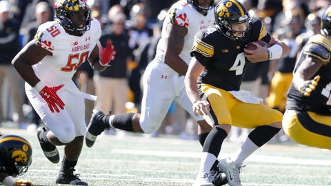 <p>               Iowa quarterback Nate Stanley (4) scrambles from Maryland linebacker Mbi Tanyi (50) during the first half of an NCAA college football game, Saturday, Oct. 20, 2018, in Iowa City, Iowa. (AP Photo/Charlie Neibergall)             </p>