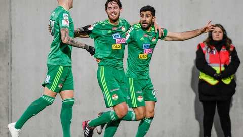 <p>               In this photo taken on Saturday Oct. 20, 2018, Dalkurds Robin Tranberg, center, celebrates scoring with teammates Adam Stahl, left, and Eero Markkanen, during their Swedish League soccer match between Dalkurd and Orebro at Gavlevallen soccer field in Gavle, Sweden. The 14-year journey of the soccer team known as Dalkurd began as a social project to get misbehaving kids off the street in a rural town in central Sweden. Now, it has grown into a top-flight squad that has given the Kurdish minority - scattered and ravaged by war - something to cherish as its own. (Pontus Lundahl/TT via AP)             </p>