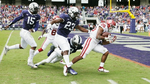 <p>               FILE - In this Oct. 20, 2018, file photo, Oklahoma running back Kennedy Brooks (26) battles past TCU defensive end Ben Banogu (15), linebacker Alec Dunham (23) and safety Markell Simmons (3) to score a touchdown during the first half of an NCAA college football game, in Fort Worth, Texas. Oklahoma won 52-27. Oklahoma might have found its newest freshman phenom at running back in Kennedy Brooks. He ran for 168 yards against TCU (AP Photo/Brandon Wade)             </p>