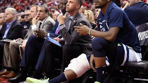 <p>               FILE - In this April 25, 2018, file photo, Minnesota Timberwolves guard Jimmy Butler, right, watches from the bench during the second half in Game 5 of the team's first-round NBA basketball playoff series against the Houston Rockets, in Houston. With Butler's status still unresolved, coach Tom Thibodeau and the Timberwolves head toward the season coming off the franchise's first playoff appearance in 14 years but carrying yet a still-cloudy outlook despite the super-max contract Karl-Anthony Towns.(AP Photo/Eric Christian Smith, File)             </p>