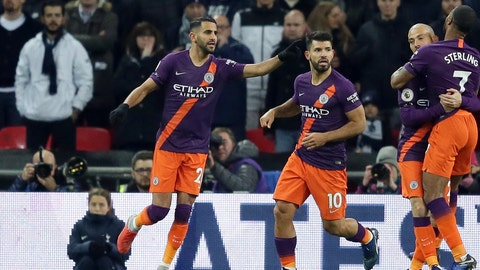 <p>               Manchester City's Riyad Mahrez, left, celebrates after scoring the opening goal during the English Premier League soccer match between Tottenham Hotspur and Manchester City at Wembley stadium in London, England, Monday, Oct. 29, 2018. (AP Photo/Tim Ireland)             </p>