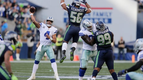 <p>               FILE - In this Sept. 23, 2018, file photo, Seattle Seahawks linebacker Mychal Kendricks (56) leaps as Dallas Cowboys quarterback Dak Prescott (4) attempts a pass during the second half of an NFL football game in Seattle. The Cowboys, who can't find anything remotely resembling a rhythm with quarterback Dak Prescott and a new group of receivers, are at home this week against the Detroit Lions. (AP Photo/John Froschauer, File)             </p>