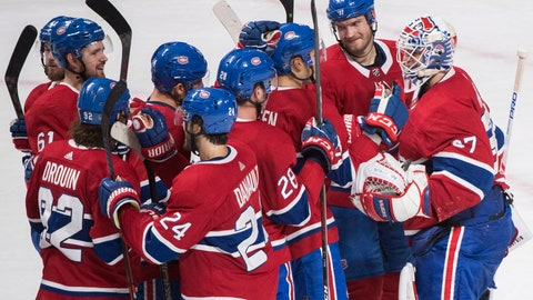 <p>               Players from the Montreal Canadiens celebrate after defeating the Pittsburgh Penguins in an NHL hockey game, Saturday, Oct. 13, 2018 in Montreal.  (Graham Hughes/Canadian Press via AP)             </p>