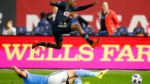 <p>               New York City FC defender Maxime Chanot, bottom, plays the ball against Philadelphia Union forward Fafa Picault during the first half of an MLS playoff soccer match Wednesday, Oct. 31, 2018, in New York. (AP Photo/Noah K. Murray)             </p>