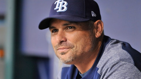 <p>               FILE - In this Aug. 23, 2018, file photo, Tampa Bay Rays manager Kevin Cash sits in the dugout before a baseball game against the Kansas City Royals, in St. Petersburg, Fla. The Tampa Bay Rays, who won more games than any American League team that didn't make the playoffs, have rewarded manager Kevin Cash with a contract extension that runs through 2024, plus a club option for 2025. (AP Photo/Steve Nesius, FIle)             </p>