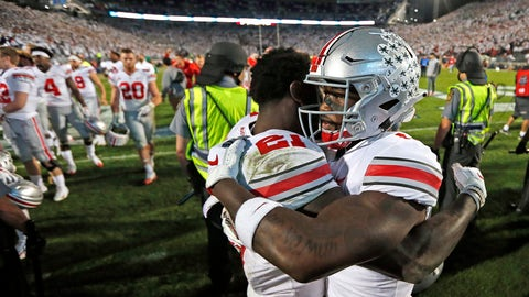 <p>               Ohio State's Paris Campbell (21), and Johnnie Dixon (1) embrace after beating Penn State 27-26 in an NCAA college football game in State College, Pa., Saturday, Sept. 29, 2018. (AP Photo/Chris Knight)             </p>