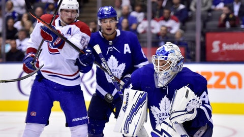 <p>               Toronto Maple Leafs goaltender Garret Sparks, right, makes a save as teammate Connor Carrick (8) ties up Montreal Canadiens left winger Artturi Lehkonen (62) during third-period NHL hockey preseason game action in Toronto, Monday, Sept. 24, 2018. (Frank Gunn/The Canadian Press via AP)             </p>