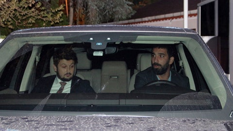<p>               Barcelona's Turkish player Arda Turan, right, leaves a police station in Istanbul, Thursday, Oct. 11, 2018. Turan has given testimony to police following a nightclub brawl during which he reportedly broke the nose of a singer.  The DHA news agency said Turan, who is on loan to Istanbul side Basaksehir, was called to a police station where he was questioned for three hours on Thursday. (IHA via AP)             </p>