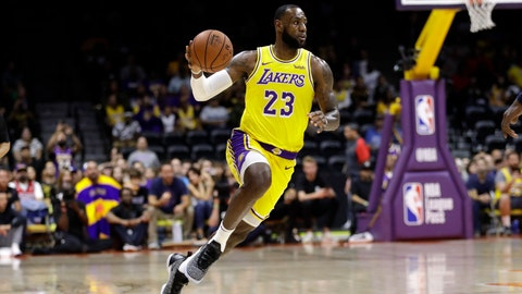 <p>               Los Angeles Lakers forward LeBron James dribbles during the first half of an NBA preseason basketball game against the Denver Nuggets, Sunday, Sept. 30, 2018, in San Diego. (AP Photo/Gregory Bull)             </p>