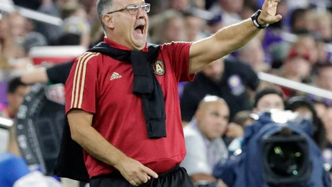 "<p>               FILE - In this Aug. 24, 2018, file photo, Atlanta United MLS soccer team head coach Gerado """"Tata"" Martino directs his players during the second half of a match against Orlando City, in Orlando, Fla.  Coach Tata Martino is leaving Atlanta United at the end of the MLS season. United made the announcement Tuesday, Oct. 23, 2018, saying Martino turned down an offer to extend his two-year contract beyond 2018. (AP Photo/John Raoux, File)             </p>"