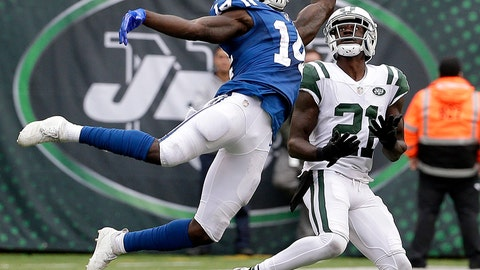 <p>               Indianapolis Colts wide receiver Zach Pascal (14) is unable to catch a pass from quarterback Andrew Luck, not pictured, as New York Jets cornerback Morris Claiborne (21) defends during the second half of an NFL football game, Sunday, Oct. 14, 2018, in East Rutherford, N.J. (AP Photo/Seth Wenig)             </p>