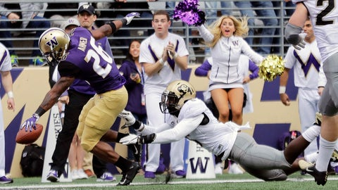 <p>               Washington running back Salvon Ahmed, left, scores a touchdown ahead of Colorado linebacker Davion Taylor during the first half of an NCAA college football game, Saturday, Oct. 20, 2018, in Seattle. (AP Photo/Ted S. Warren)             </p>