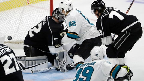 <p>               San Jose Sharks' Kevin Labanc (62) scores the game-winning goal past Los Angeles Kings goaltender Jonathan Quick, left, during overtime of an NHL hockey game Friday, Oct. 5, 2018, in Los Angeles. San Jose won 3-2. (AP Photo/Marcio Jose Sanchez)             </p>