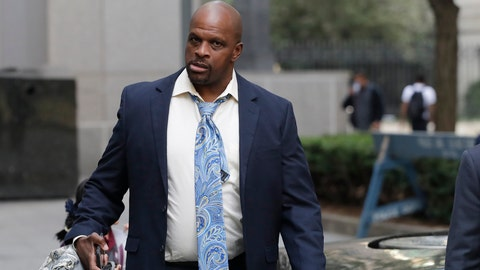 """<p>               THIS CORRECTS THE IDENTIFICATION TO BRIAN BOWEN SR., AND NOT MERL CODE, AS ORIGINALLY SENT - Brian Bowen Sr. arrives at federal court, Thursday, Oct. 4, 2018, in New York. When Brian Bowen Jr., one of America's brightest high school basketball stars, announced in June 2017 that he would attend the University of Louisville, a school that had not been on anyone's radar as his possible destination, sportswriters called it a coup that """"came out of nowhere."""" In a trial that began Monday, federal prosecutors will argue that the signing wasn't luck at all but the result of a payoff to Bowen's father.  (AP Photo/Mark Lennihan)             </p>"""