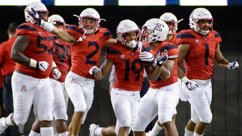 Oct 6, 2018; Tucson, AZ, USA; Arizona Wildcats safety Scottie Young Jr. (19) (middle) celebrates with cornerback Lorenzo Burns (2) (left) after intercepting the ball and scoring a touchdown against the California Golden Bears during the second half at Arizona Stadium. Mandatory Credit: Casey Sapio-USA TODAY Sports