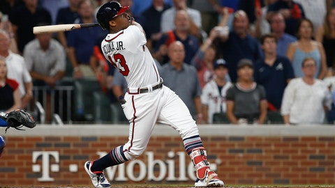 ATLANTA, GA - OCTOBER 8:  Ronald Acuna Jr. #13 of the Atlanta Braves hits a grand slam in the second inning during Game 3 of the NLDS against the Los Angeles Dodgers at SunTrust Park on Sunday, October 8, 2018 in Atlanta, Georgia. (Photo by Mike Zarilli/MLB Photos via Getty Images)