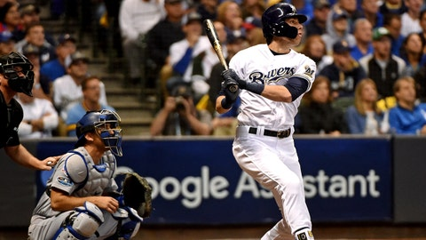 Oct 20, 2018; Milwaukee, WI, USA; Milwaukee Brewers right fielder Christian Yelich (22) hits a home run during the first inning against the Los Angeles Dodgers in game seven of the 2018 NLCS playoff baseball series at Miller Park. Mandatory Credit: Benny Sieu-USA TODAY Sports