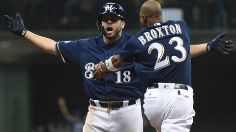 Oct 4, 2018; Milwaukee, WI, USA;  Milwaukee Brewers third baseman Mike Moustakas (18) celebrates with Keon Broxton (23) after hitting a walk off RBI single against the Colorado Rockies in the 10th inning in game one of the 2018 NLDS playoff baseball series at Miller Park. Mandatory Credit: Benny Sieu-USA TODAY Sports