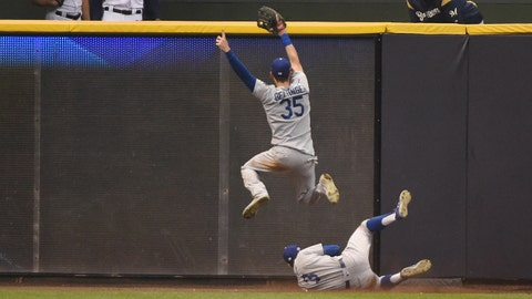 Oct 20, 2018; Milwaukee, WI, USA; Los Angeles Dodgers outfielder Chris Taylor (3) slides and avoids teammate Cody Bellinger (35) to make a catch on a ball hit by Milwaukee Brewers outfielder Christian Yelich (not pictured) in the fifth inning in game seven of the 2018 NLCS playoff baseball series at Miller Park. Mandatory Credit: Benny Sieu-USA TODAY Sports