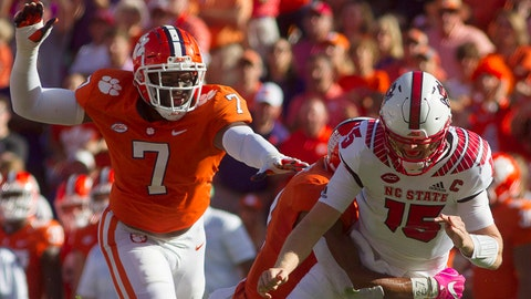 Oct 20, 2018; Clemson, SC, USA; North Carolina State Wolfpack quarterback Ryan Finley (15) is brought down after passing during the second quarter of the game against the Clemson Tigers at Clemson Memorial Stadium. Mandatory Credit: Joshua S. Kelly-USA TODAY Sports