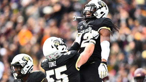 Oct 6, 2018; Boulder, CO, USA; Colorado Buffaloes wide receiver Laviska Shenault Jr. (2) celebrates his touchdown carry with offensive lineman Brett Tonz (55) s in the first quarter against the Arizona State Sun Devils at Folsom Field. Mandatory Credit: Ron Chenoy-USA TODAY Sports