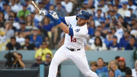 LOS ANGELES, CA - OCTOBER 17:  Max Muncy #13 of the Los Angeles Dodgers hits a RBI single in the sixth inning against the Milwaukee Brewers in Game Five of the National League Championship Series at Dodger Stadium on October 17, 2018 in Los Angeles, California.  (Photo by Kevork Djansezian/Getty Images)