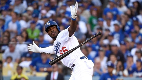 LOS ANGELES, CA - OCTOBER 17:  Yasiel Puig #66 of the Los Angeles Dodgers reacts after hitting a RBI single in the sixth inning against the Milwaukee Brewers in Game Five of the National League Championship Series at Dodger Stadium on October 17, 2018 in Los Angeles, California.  (Photo by Kevork Djansezian/Getty Images)