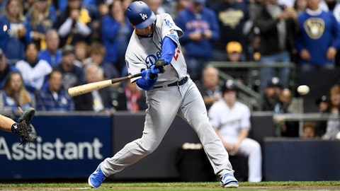 MILWAUKEE, WI - OCTOBER 19:  David Freese #25 of the Los Angeles Dodgers hits a solo home run against Wade Miley #20 of the Milwaukee Brewers during the first inning in Game Six of the National League Championship Series at Miller Park on October 19, 2018 in Milwaukee, Wisconsin.  (Photo by Stacy Revere/Getty Images)