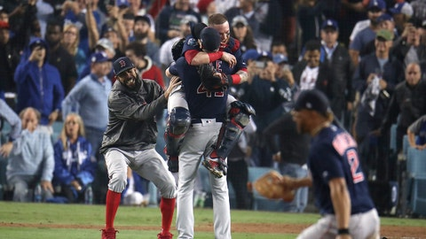 LOS ANGELES - OCTOBER 28: Boston Red Sox catcher Christian Vazquez jumps onto pitcher Chris Sale after the Red Sox defeated the Dodgers 5-1. The Los Angeles Dodgers host the Boston Red Sox in Game 5 of the World Series at Dodger Stadium in Los Angeles on Oct. 28, 2018. (Photo by Stan Grossfeld/The Boston Globe via Getty Images)