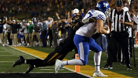 COLUMBIA, MO - OCTOBER 27:  Tight end C.J. Conrad #87 of the Kentucky Wildcats catches a pass in the endzone for a touchdown as time expires while safety Tyree Gillespie #9 of the Missouri Tigers defends during the game at Faurot Field/Memorial Stadium on October 27, 2018 in Columbia, Missouri.  The Wildcats defeated the Tigers with a final score of 15-14.  (Photo by Jamie Squire/Getty Images)