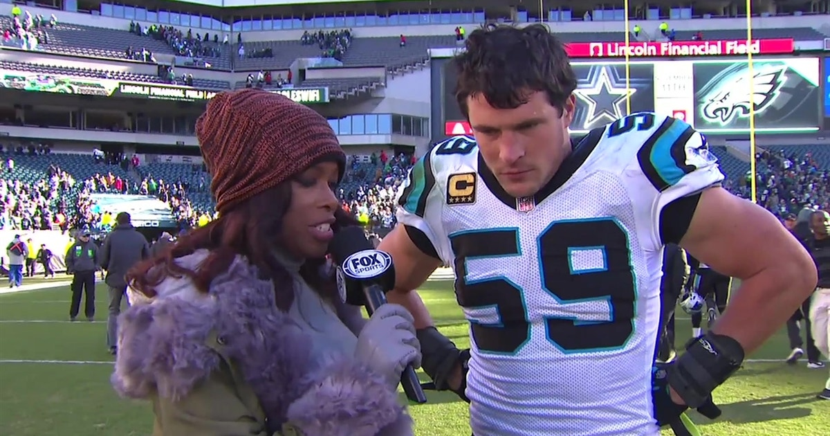 Luke Kuechly talks to Pam Oliver after the Panthers' incredible comeback win against the Eagles