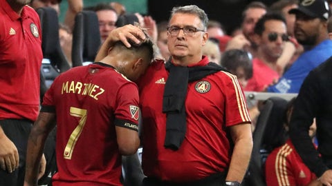 Aug 4, 2018; Atlanta, GA, USA; Atlanta United head coach Gerardo Martino, facing, greets forward Josef Martinez (7) after Martinez comes off of the field in the second half during the match against Toronto FC at Mercedes-Benz Stadium. Mandatory Credit: Jason Getz-USA TODAY Sports