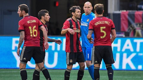 Oct 21, 2018; Atlanta, GA, USA; Atlanta United players celebrate with goalkeeper Brad Guzan (1) after defeating the Chicago Fire at Mercedes-Benz Stadium. Mandatory Credit: Dale Zanine-USA TODAY Sports