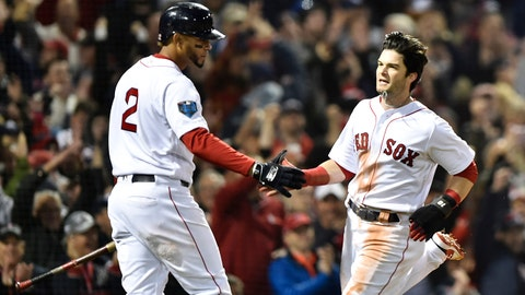 Oct 23, 2018; Boston, MA, USA; Boston Red Sox outfielder Andrew Benintendi (right) celebrates with shortstop Xander Bogaerts (2) after scoring a run against the Los Angeles Dodgers in the first inning in game one of the 2018 World Series at Fenway Park. Mandatory Credit: Bob DeChiara-USA TODAY Sports