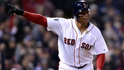 Oct 23, 2018; Boston, MA, USA; Boston Red Sox third baseman Rafael Devers celebrates his RBI single against the Los Angeles Dodgers in the fifth inning in game one of the 2018 World Series at Fenway Park. Mandatory Credit: Bob DeChiara-USA TODAY Sports