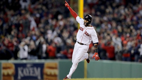 BOSTON, MA - OCTOBER 23:  Eduardo Nunez #36 of the Boston Red Sox celebrates his three-run home run during the seventh inning against the Los Angeles Dodgers in Game One of the 2018 World Series at Fenway Park on October 23, 2018 in Boston, Massachusetts.  (Photo by Elsa/Getty Images)