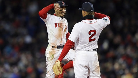 BOSTON, MA - OCTOBER 24:  Mookie Betts #50 and Xander Bogaerts #2 of the Boston Red Sox celebrate their teams 4-2 win over the Los Angeles Dodgers in Game Two of the 2018 World Series at Fenway Park on October 24, 2018 in Boston, Massachusetts.  (Photo by Elsa/Getty Images)