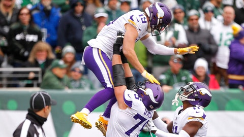 Oct 21, 2018; East Rutherford, NJ, USA; Minnesota Vikings wide receiver Adam Thielen (19) celebrates after scoring a touchdown against the New York Jets with offensive tackle Brian O'Neill (75) and wide receiver Laquon Treadwell (11) during the first quarter at MetLife Stadium. Mandatory Credit: Noah K. Murray-USA TODAY Sports