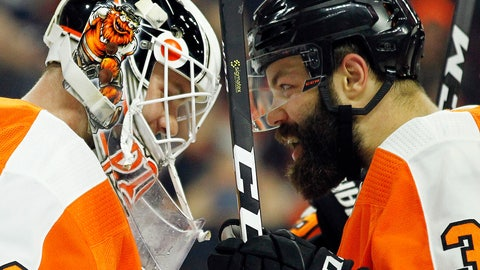 <p>               Philadelphia Flyers goalie Calvin Pickard, left, and Radko Gudas, right, celebrate after the Flyers won 6-5 in the shootout of an NHL hockey game against the Florida Panthers, Tuesday, Oct. 16, 2018, in Philadelphia. (AP Photo/Tom Mihalek)             </p>
