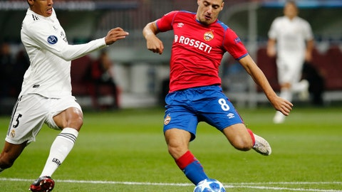 <p>               CSKA midfielder Nikola Vlasic, right, kicks the ball ahead of Real defender Raphael Varane during a Group G Champions League soccer match between CSKA Moscow and Real Madrid at the Luzhniki Stadium in Moscow, Russia, Tuesday, Oct. 2, 2018. (AP Photo/Alexander Zemlianichenko)             </p>