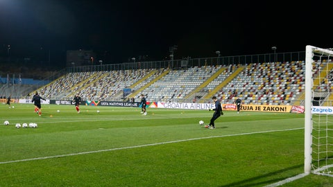 <p>               Croatian players warm up in a stadium without spectators prior the UEFA Nations League soccer match between Croatia and England at Rujevica stadium in Rijeka, Croatia, Friday, Oct. 12, 2018. Croatia are serving the second part of their two-game punishment imposed by UEFA after a swastika was marked on their pitch before a Euro 2016 qualifier against Italy. (AP Photo/Darko Bandic)             </p>