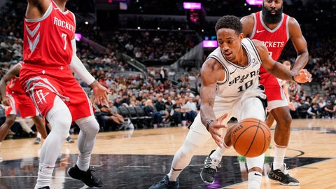 <p>               San Antonio Spurs' DeMar DeRozan (10) tangles with Houston Rockets' Carmelo Anthony (7) and James Harden during the second half of an NBA preseason basketball game, Sunday, Oct. 7, 2018, in San Antonio. (AP Photo/Darren Abate)             </p>