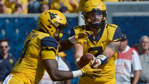 <p>               West Virginia quarterback Will Grier (7) hands off the football to running back Leddie Brown (4) during the first half of an NCAA college football game against Kansas in Morgantown, W. Va., Saturday Oct. 6, 2018. (AP Photo/Craig Hudson)             </p>