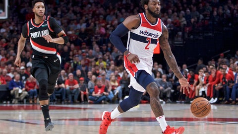 <p>               Washington Wizards guard John Wall, right, dribbles past Portland Trail Blazers guard Evan Turner during the first half of an NBA basketball game in Portland, Ore., Monday, Oct. 22, 2018. (AP Photo/Craig Mitchelldyer)             </p>