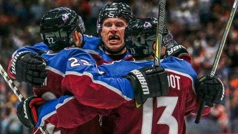 <p>               Colorado Avalanche defenseman Erik Johnson, center, hugs center Colin Wilson, left, and forward Alexander Kerfoot (13) after Wilson's goal against the Philadelphia Flyers during the first period of an NHL hockey game Saturday, Oct. 6, 2018, in Denver.(AP Photo/Joe Mahoney)             </p>